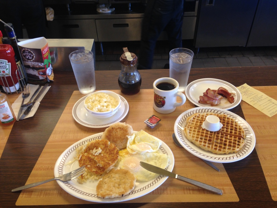 Grits, bacon, biscuit, hashbrowns, eggs, pecan waffle, coffee - all for me
